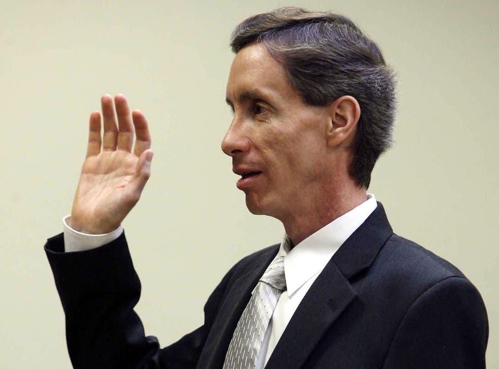 Warren Jeffs is sworn in during his preliminary hearing