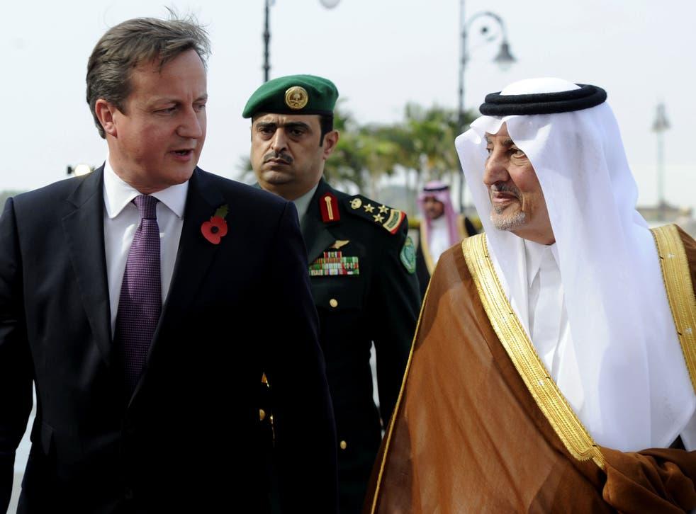Saudi Emir of Mecca, Prince Khalid bin Faisal bin Abdulaziz (R) welcomes British Prime Minister David Cameron (L) as he arrives in Jeddah on November 6, 2012.