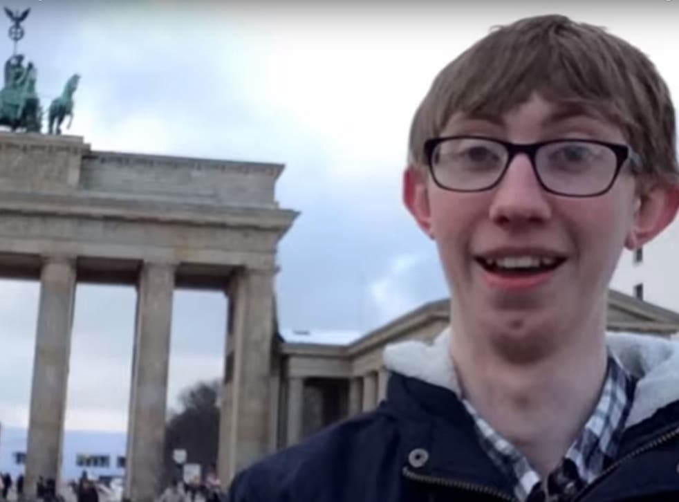 Jordan Cox outside the Brandenburg Gate in Berlin as he details how he saved money on his adventure