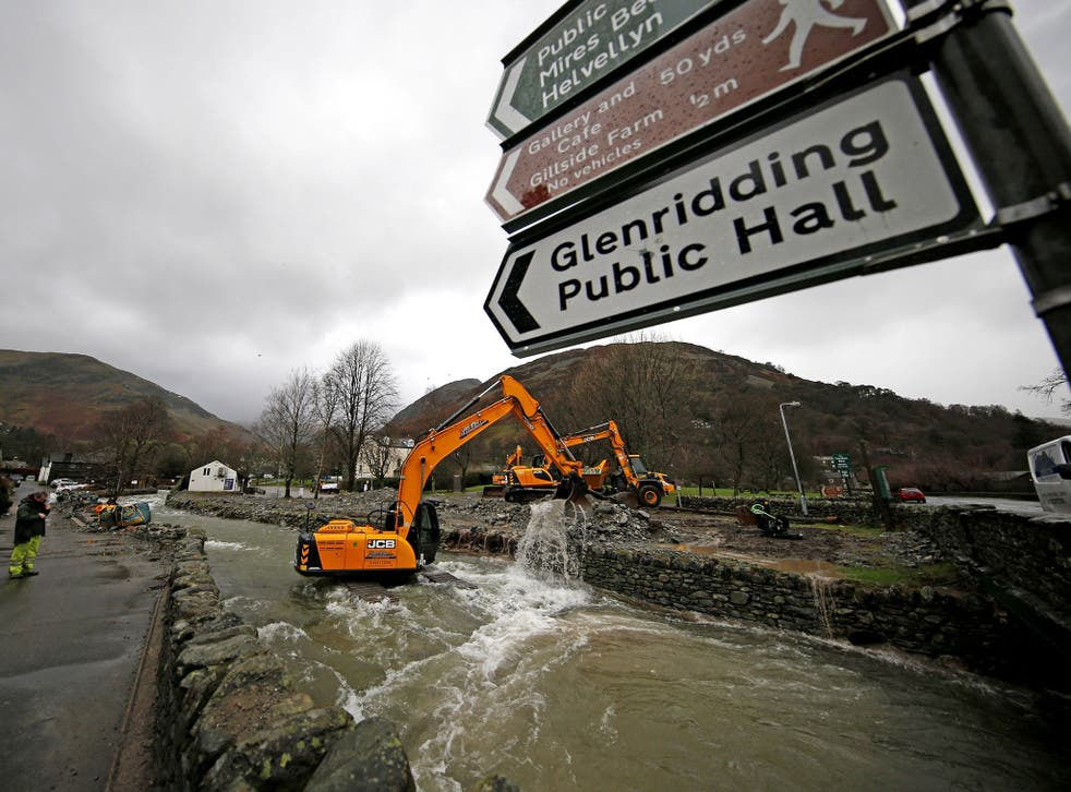 Glenridding Beck in Cumbria is dredged again to remove boulders and rocks, which were washed down from the fells during previous heavy rain, in order to prevent further flooding.
