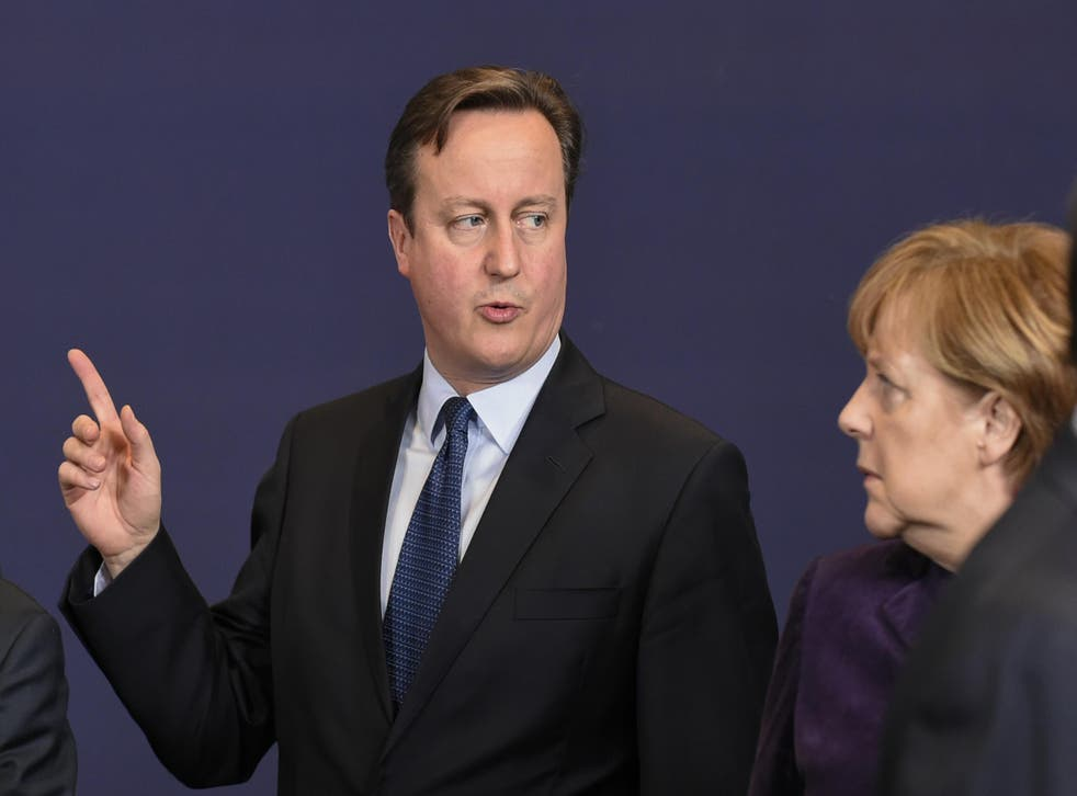 David Cameron flanked by German Chancellor Angela Merkel at the European Union (EU) summit of the year at the European Council in Brussels in December 2015