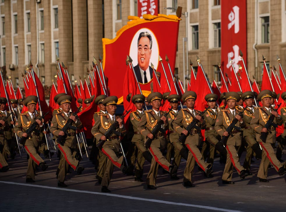 Diplomatic fallout: North Korean soldiers march past a portrait of the late Kim Il-sung in Pyongyang in 2015