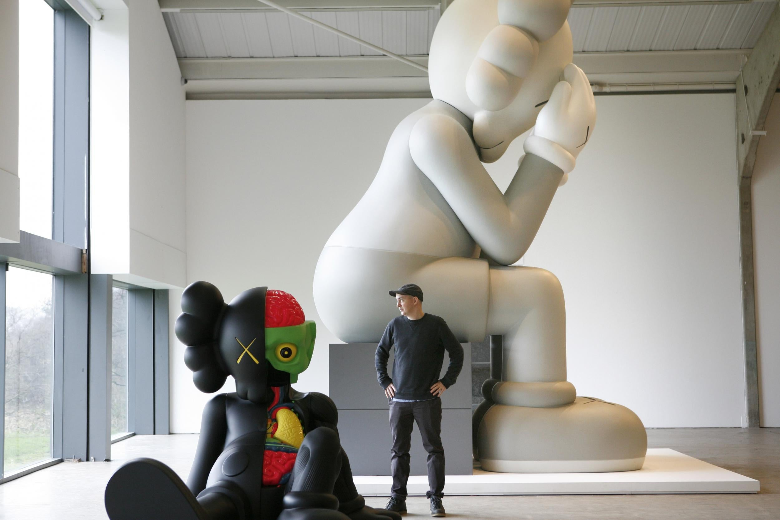 Pop Artist KAWS Gigantic Cartoon Sculptures Will Be Taking Over The - Business invoice templates free kaws online store