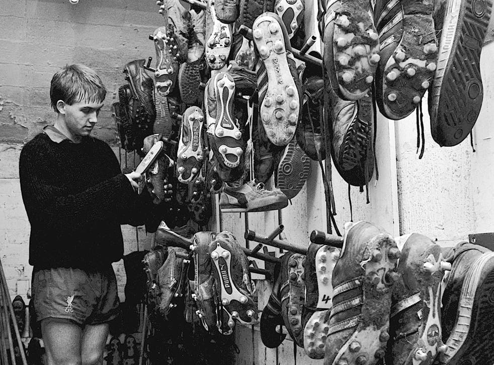 Liverpool youngster Mick Halsall cleans the boots at Anfield in 1983