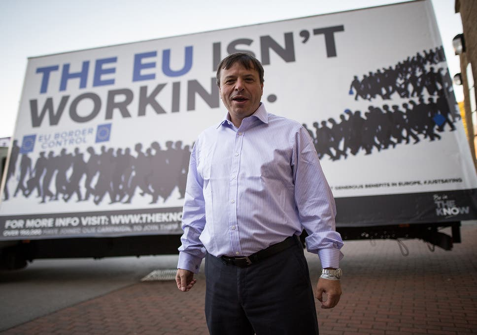 Aaron Banks in front of an ad trailer with 'The EU isn't working