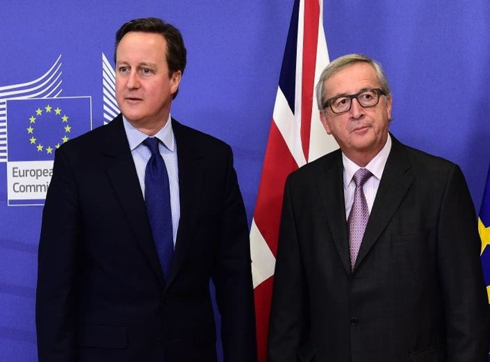 British Prime Minister David Cameron (L) is welcomed by European Commission president Jean-Claude Juncker prior to a meeting at the European Commission in Brussels.