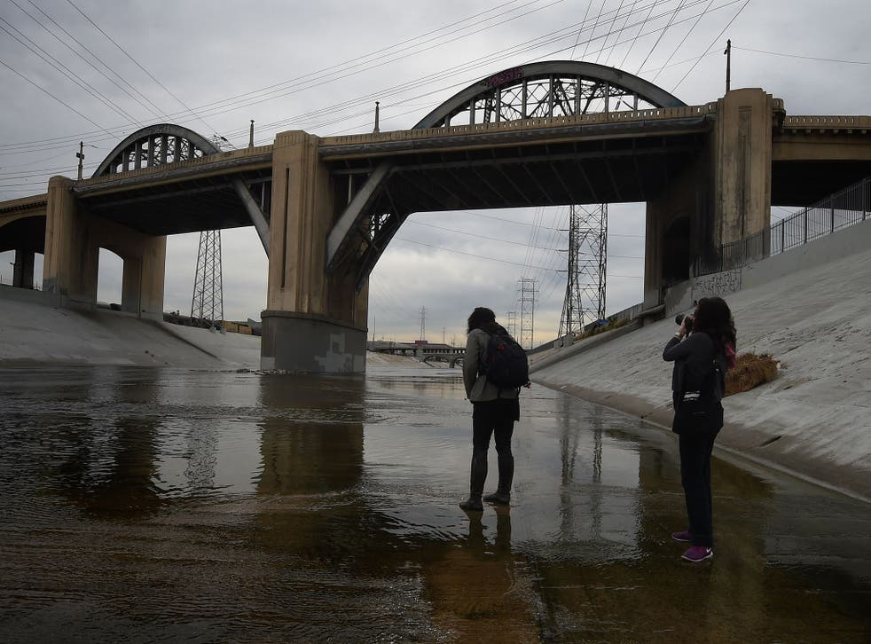 People take photographs as they come to say goodbye to the iconic 6th Street Bridge that connects downtown Los Angeles with its eastern disticts