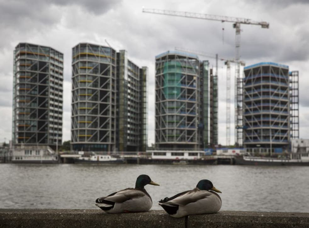 Luxury flats go up by the Thames. New figures show that property prices are booming, the average home in the capital is now worth £500,000 and the prices are being driven up