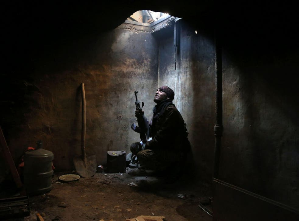 An anti-Assad fighter, in rebel-held Arbeen, near Damascus