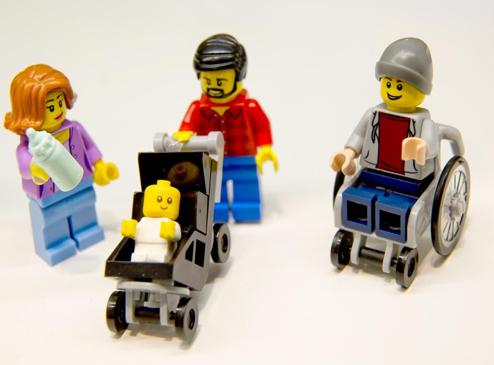 Lego figurines, including one in a wheelchair are pictured at the Lego booth