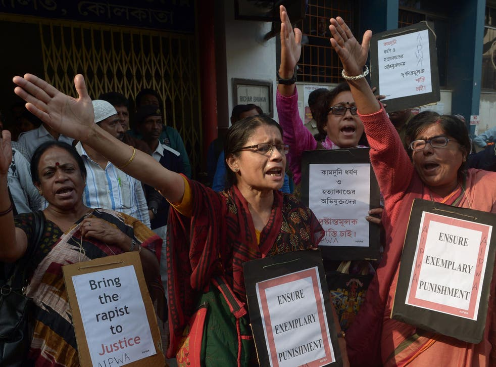 Social activists shout slogans against the judgment of the rape and murder case of Kamduni