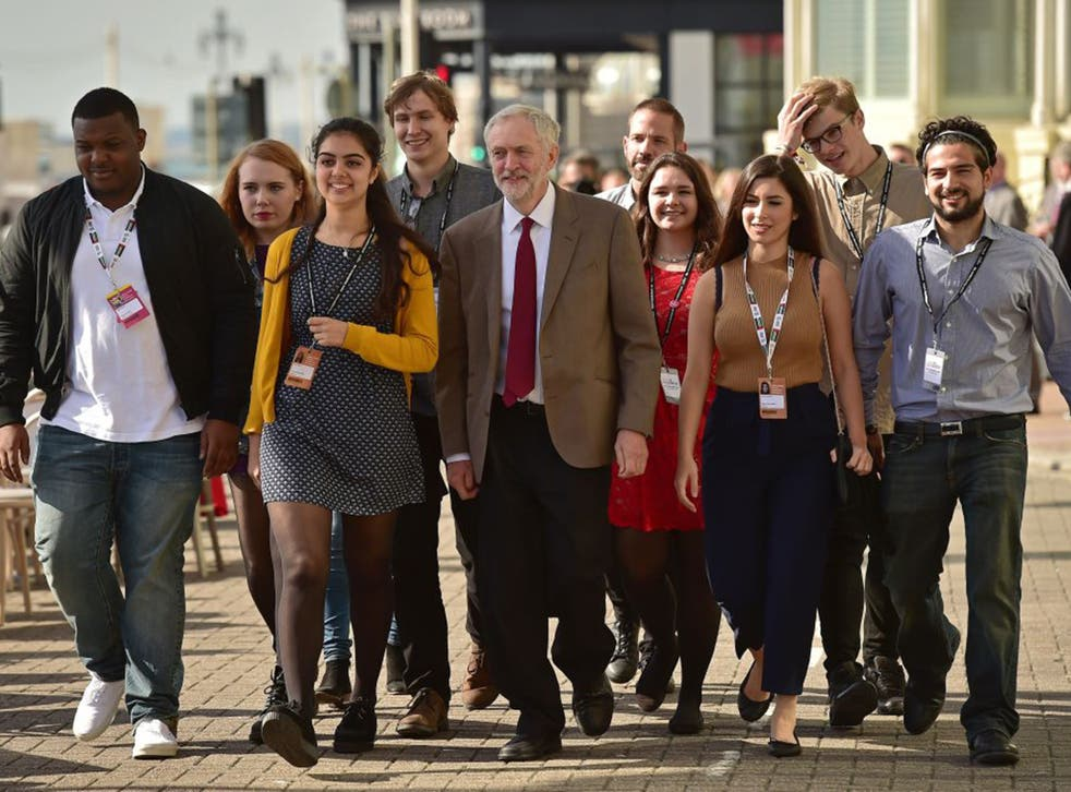 Jeremy Corbyn and supporters arrive at the Brighton Centre in September last year before the Labour leader's speech to the party conference