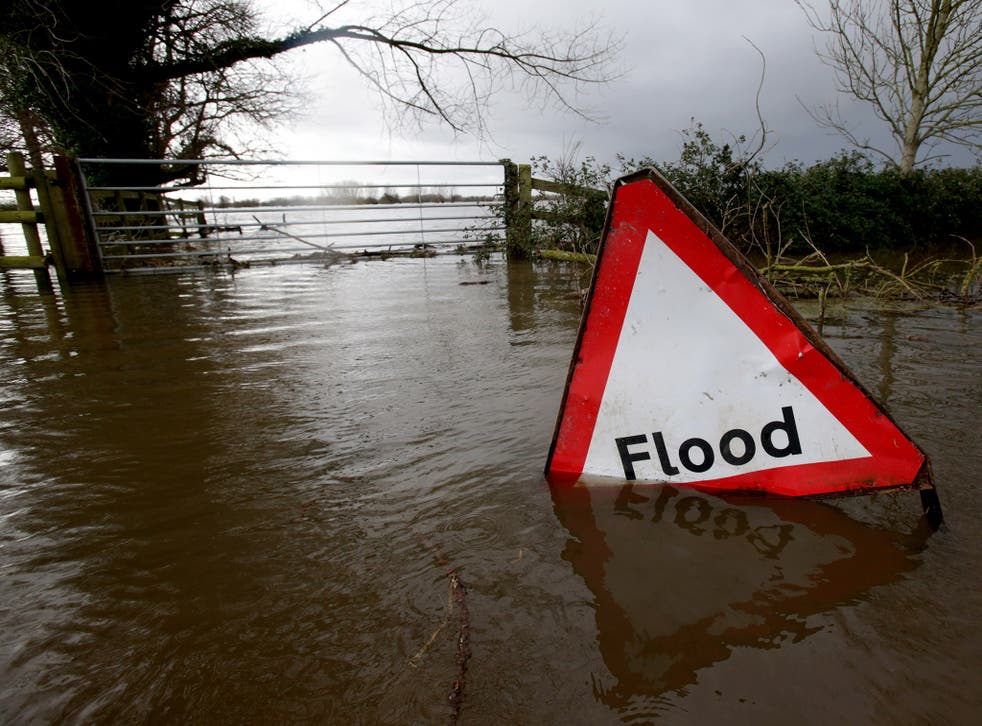 Flood waters surrounding farm buildings in Somerset in January 2014. The rains led to significant flooding in Somerset, Devon, Dorset, Cornwall and the Thames Valley