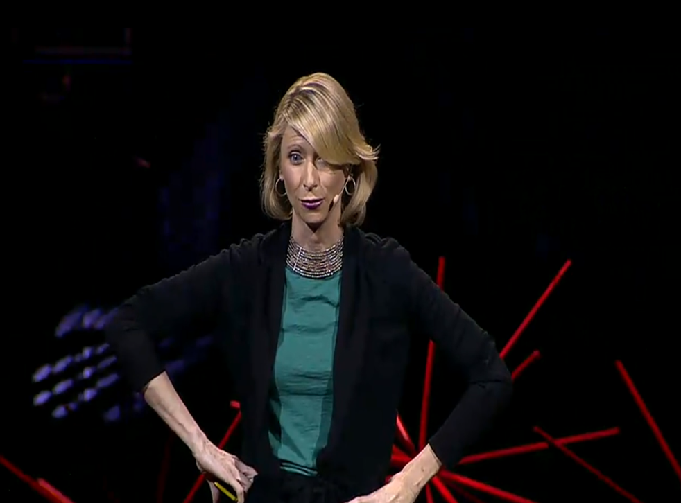 Psychologist Amy Cuddy assumes a 'high power' pose