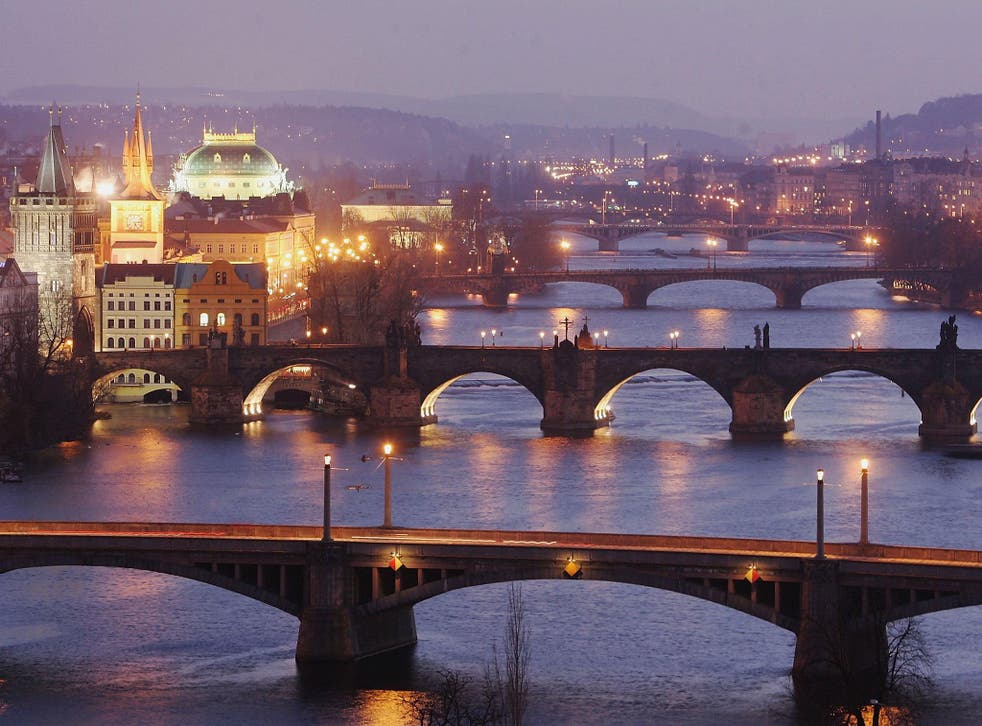 Bridges span the River Vltava in Prague, the capital city of the Czech Republic