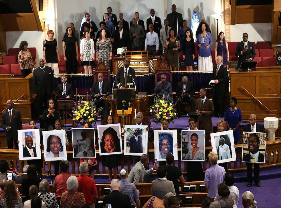 Victims of the Charleston shooting are shown at a prayer service at the Metropolitan AME Church in Washington DC.