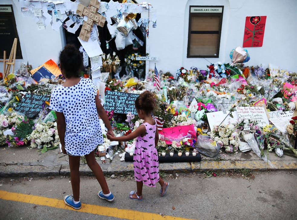 Children look on the memorial after the shooting that look nine lives in Charleston, South Carolina.