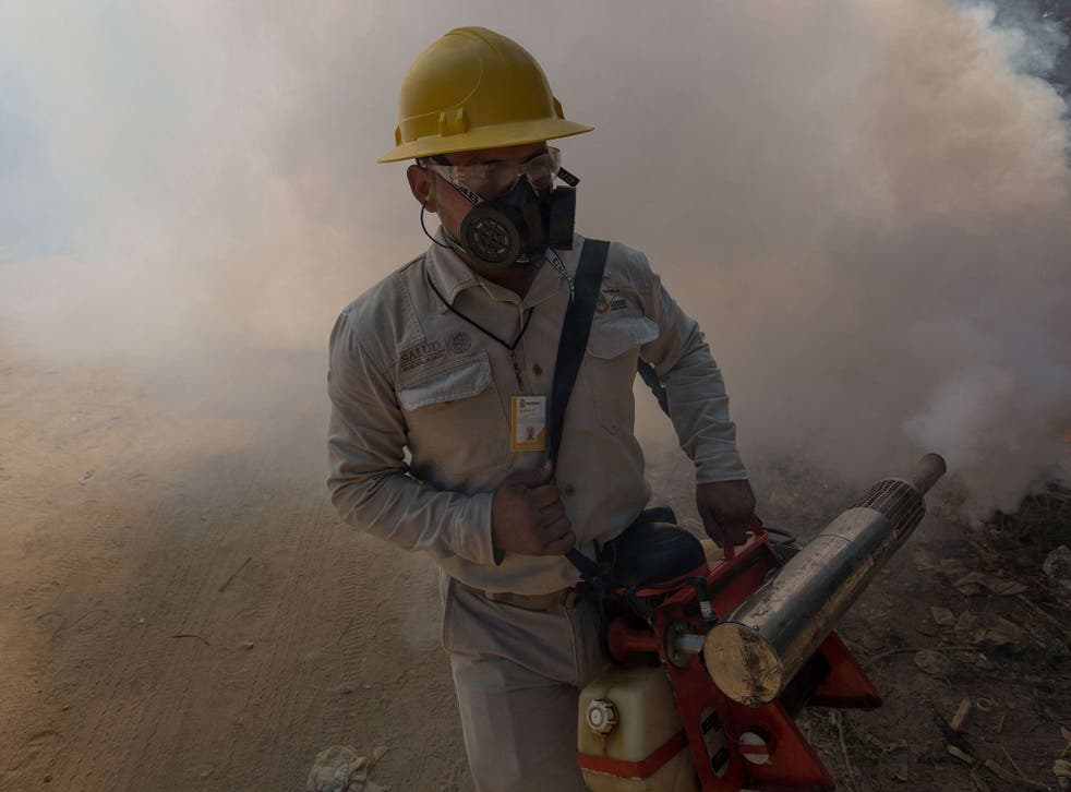 A health worker fumigates in Mexico