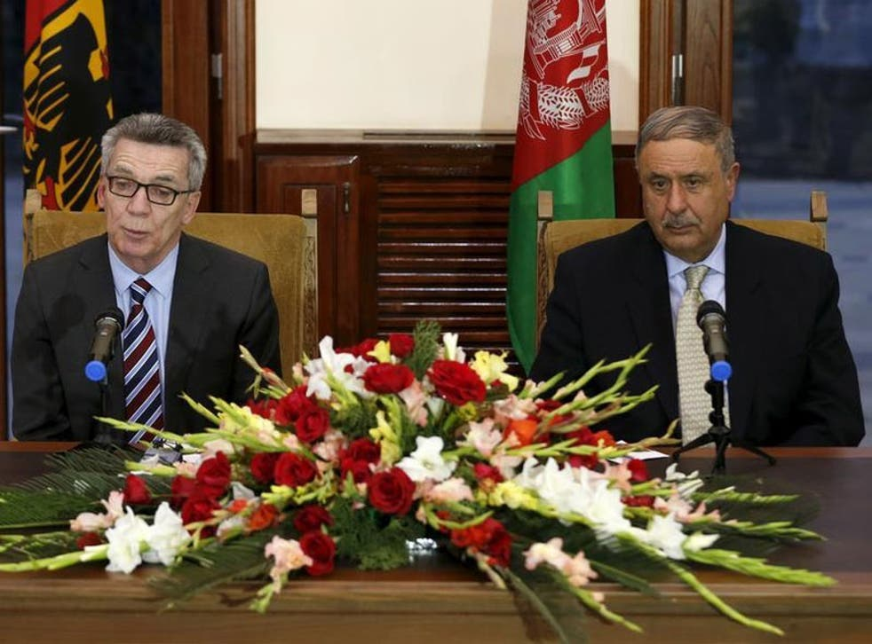 German Interior Minister Thomas de Maiziere and his Afghan counterpart Nur ul-Haq Ulumi address a joint news conference in Kabul, Afghanistan