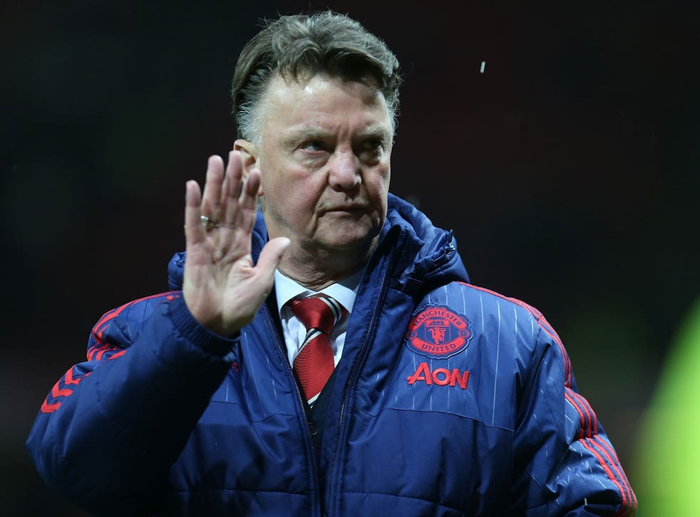 Manchester United manager Louis van Gaal waves to the fans after the 3-0 win over Stoke