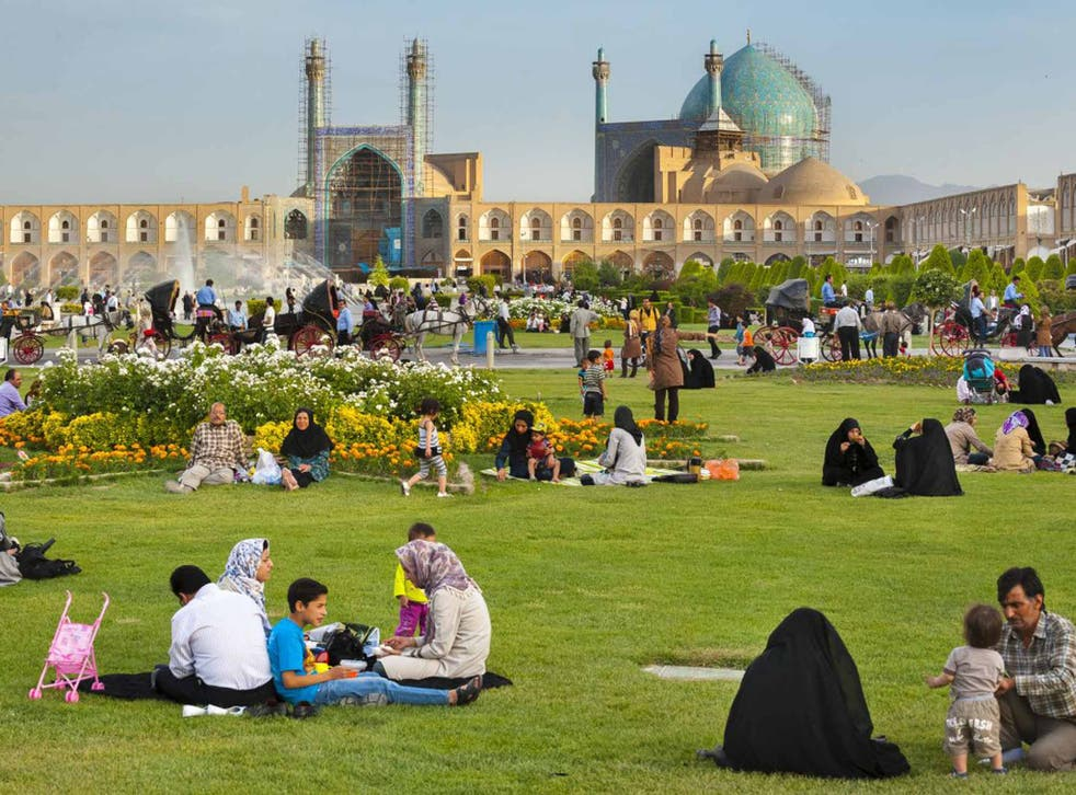 Iranian families picknicking in Naqsh-e Jahan Square, in the city of Isfahan