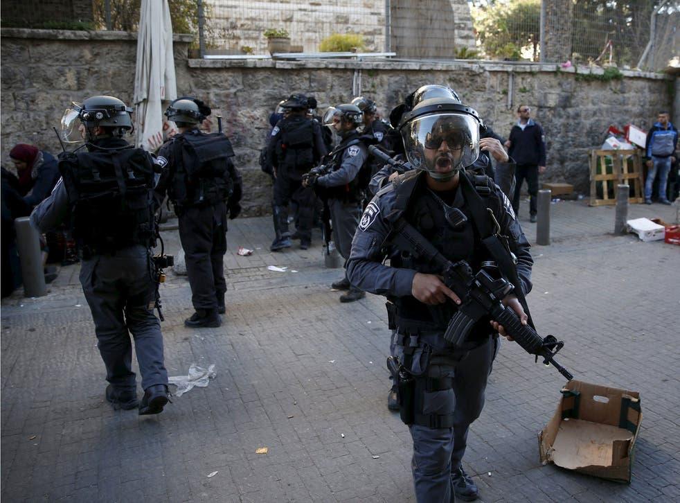 Israeli police secure an area near the scene where three Palestinians were shot dead by Israeli police