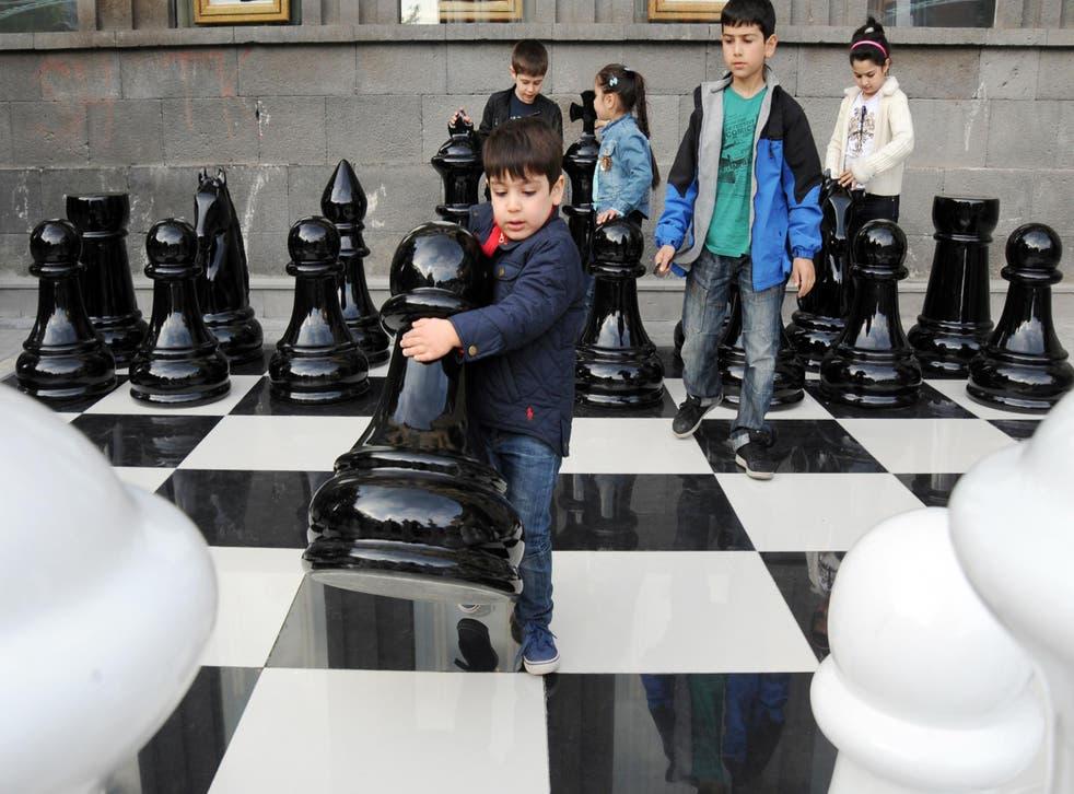 Children play jumbo chess in Yerevan, Armenia