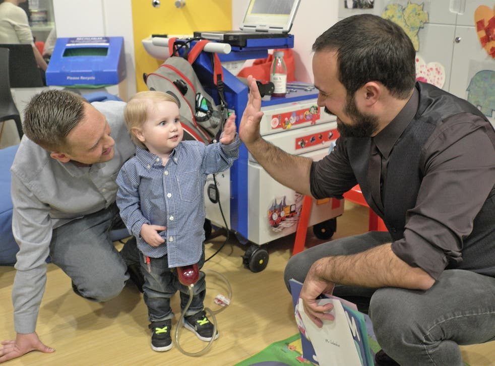 Evgeny Lebedev meets Elliott Livingstone in a Great Ormond Street Hospital playroom as part of the GOSH campaign