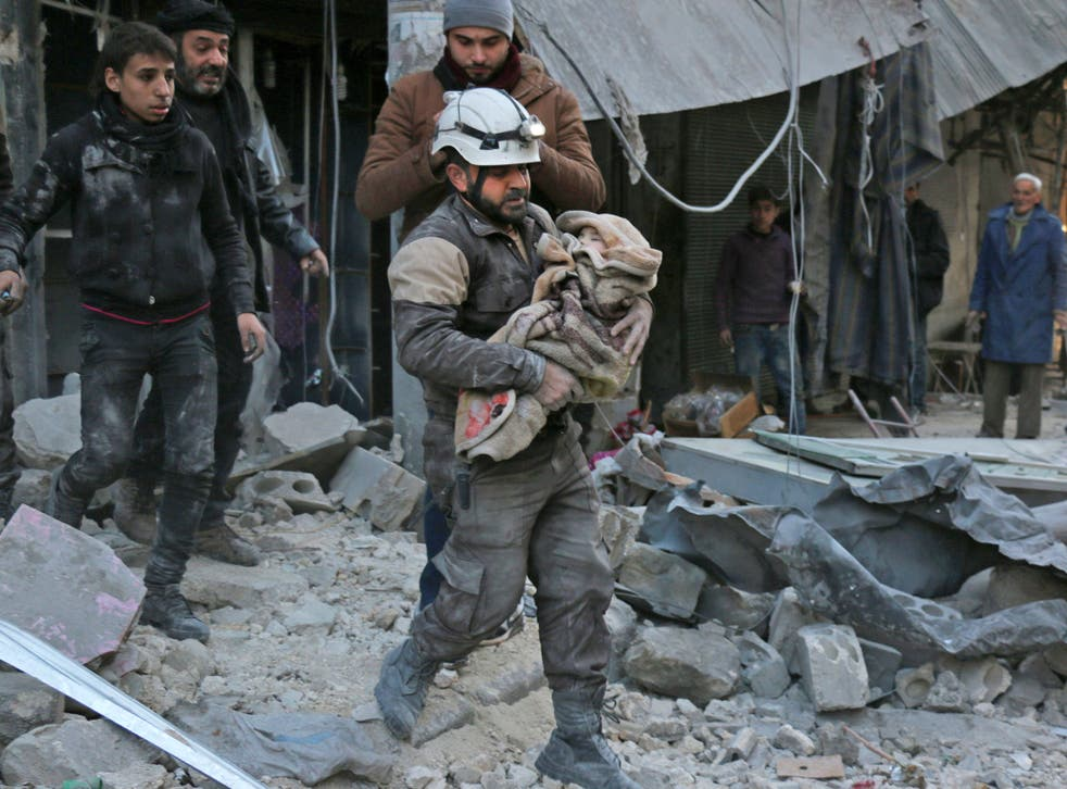 A baby is rescued following Syrian government air strikes in Aleppo last month