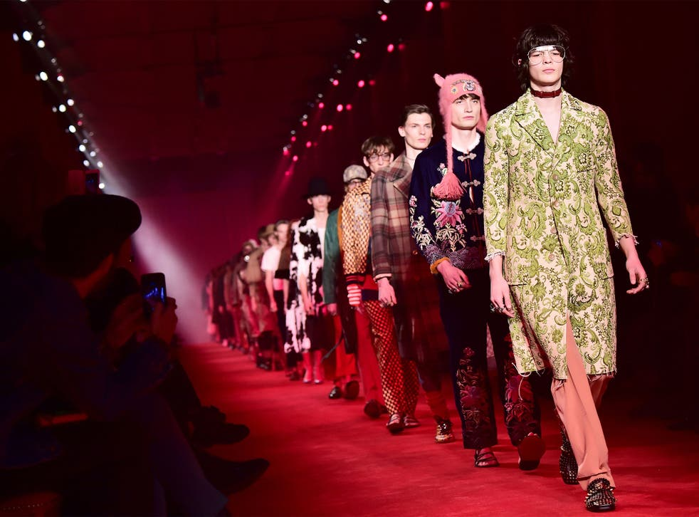 Models present creations Gucci during in Milan recently