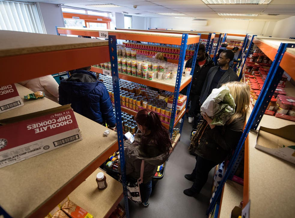 Shoppers queue to pay for their goods at the 'easyFoodstore' in north-west London