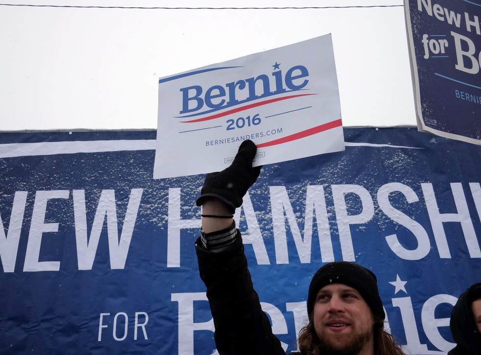 Supporters of US Democratic presidential candidate Bernie Sanders cheer on a street in Manchester, New Hampshire