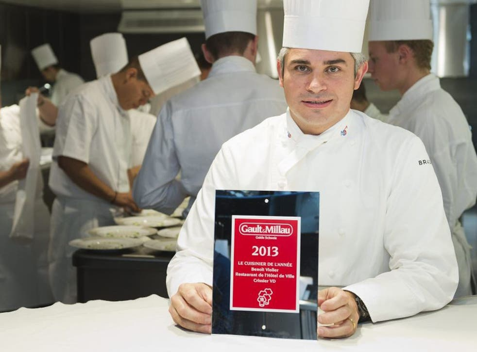 Violier in the kitchen of the Restaurant de l'Hôtel de Ville with his 2013 Chef of the Year award