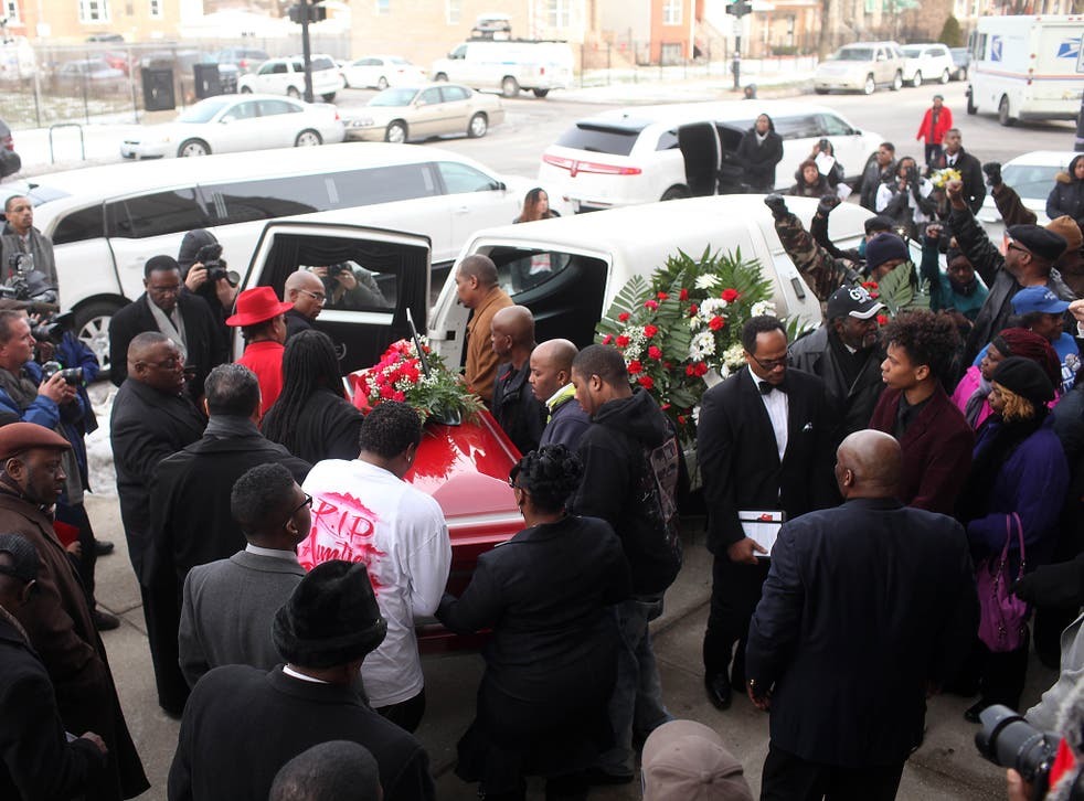 Pallbearers carry the casket of Bettie Jones during her funeral at New Mount Pilgrim Missionary Baptist Church