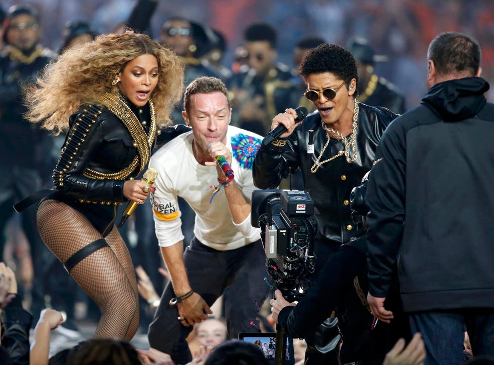 Beyonce (L), Chris Martin (C) and Bruno Mars perform during the half-time show at the NFL's Super Bowl 50 between the Carolina Panthers and the Denver Broncos in Santa Clara, California