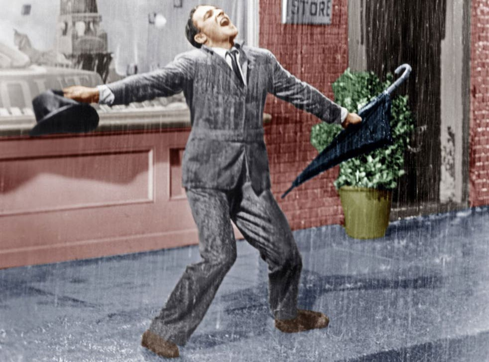 """Gene Kelly in Singin' In The Rain from 1952. Researchers are exploring techniques which will allow viewers to sense """"raindrops"""" on their hands or wind on their face as they are watching on television"""