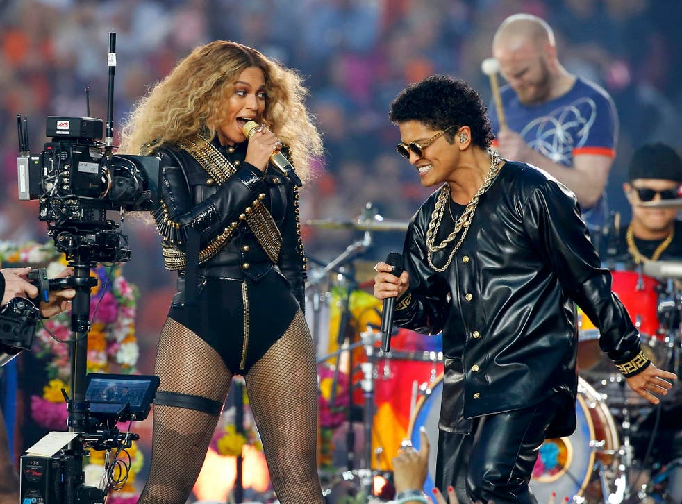 Beyonce and Bruno Mars perform during half-time show at the NFL's Super Bowl 50 football game between the Carolina Panthers and the Denver Broncos in Santa Clara, California