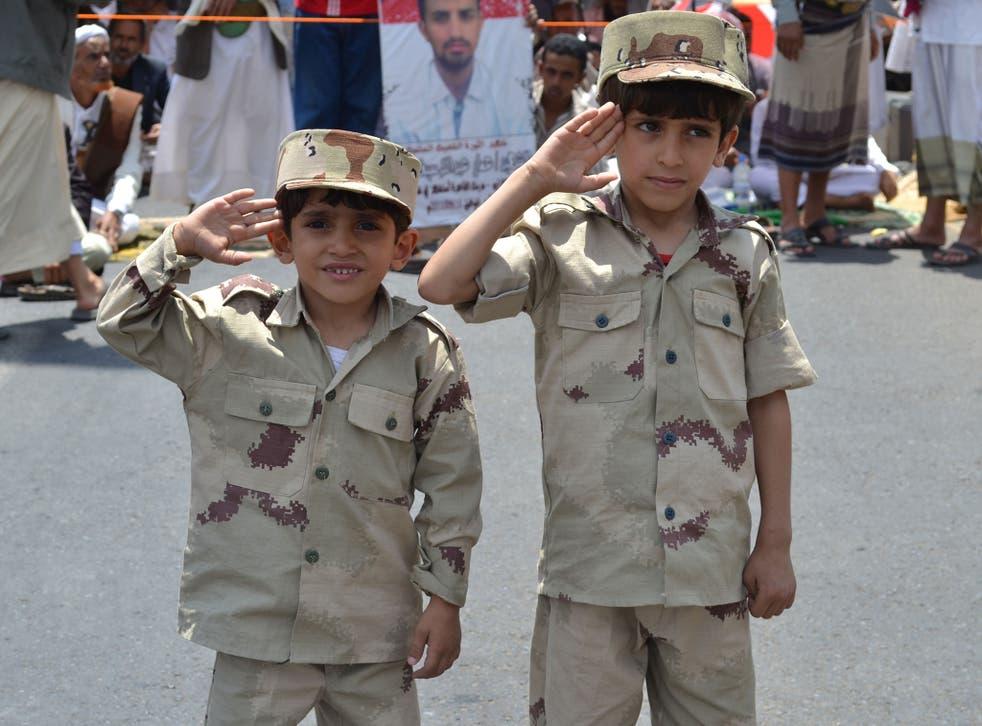 Yemeni children saluting during a military celebration in Sana'a