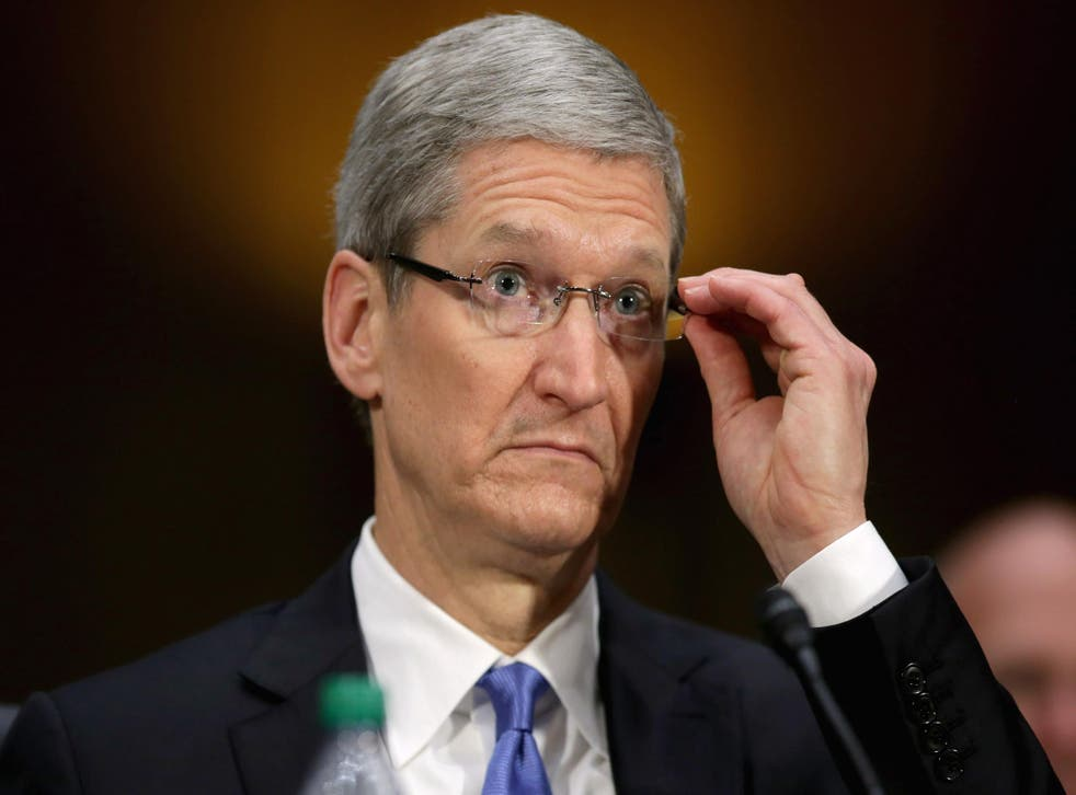 Apple CEO Tim Cook testifies before the Senate Homeland Security and Governmental Affairs Committee's Investigations Subcommittee about his company's offshore profit shifting