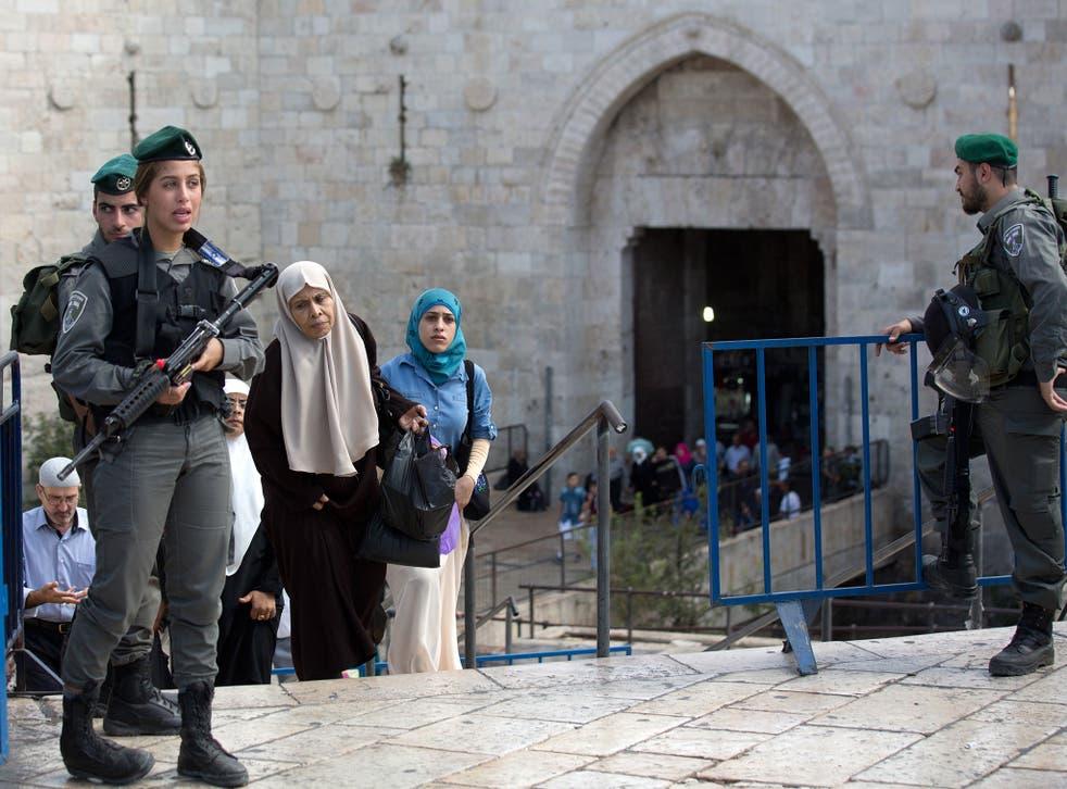 Palestinian women cross into Israel via the Damascus Gate in east Jerusalem