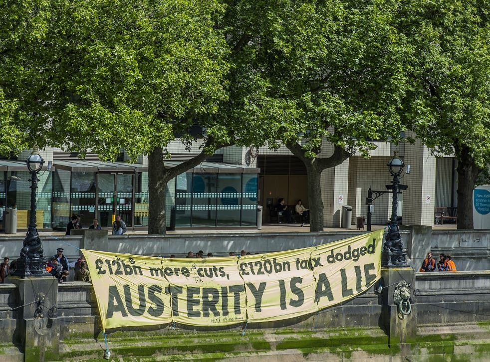 Anti-austerity protesters makes their feelings known during a demonstration in London last year