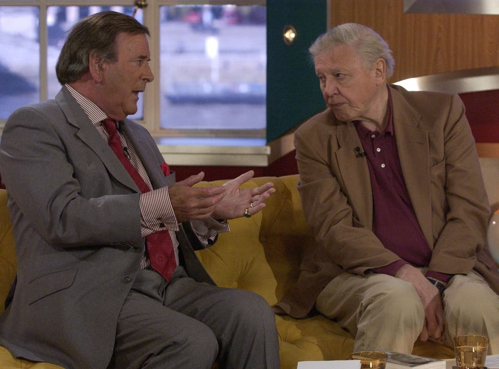Terry Wogan chats to Sir David Attenborough at the BBC in 2003, long after Wogan was rejected for a job at BBC2