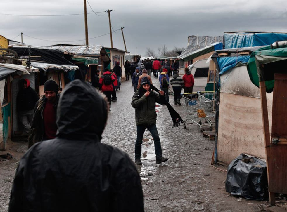 Migrants in Calais' Jungle camp last week