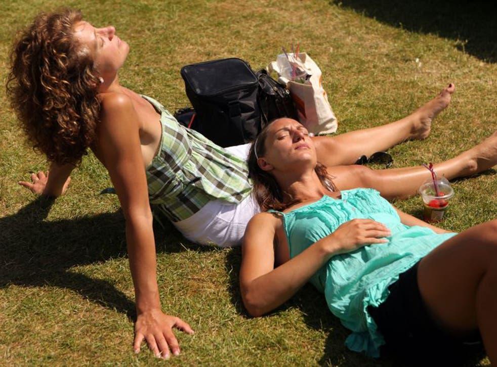 Spectators sunbathe at the Wimbledon Tennis Championships