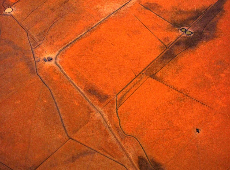 An aerial view of small dams containing water are seen in dry paddocks located north-west of the city of Melbourne January 27, 2014