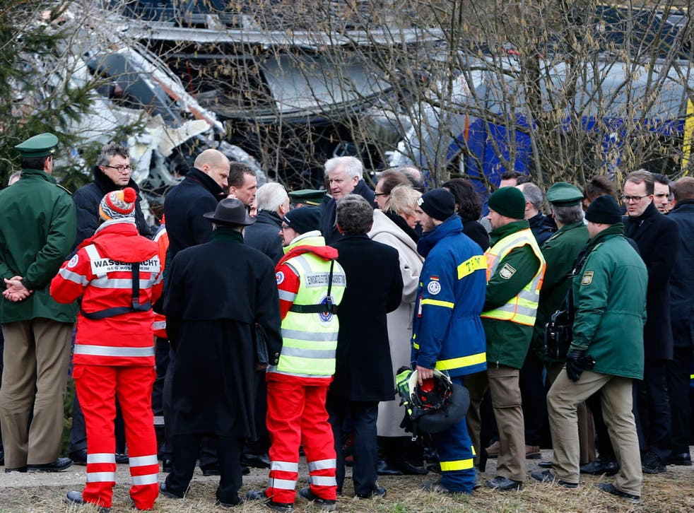 Bavarian state governor Horst Seehofer, center, arrives at the site where two trains collided head-on near Bad Aibling, Germany