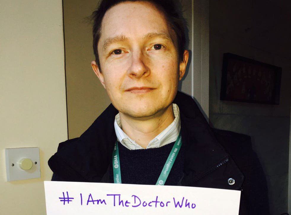 Dr Paul Watson holds a sign reading: '#IAmTheDoctorWho answered your questions when your child was admitted to intensive care '