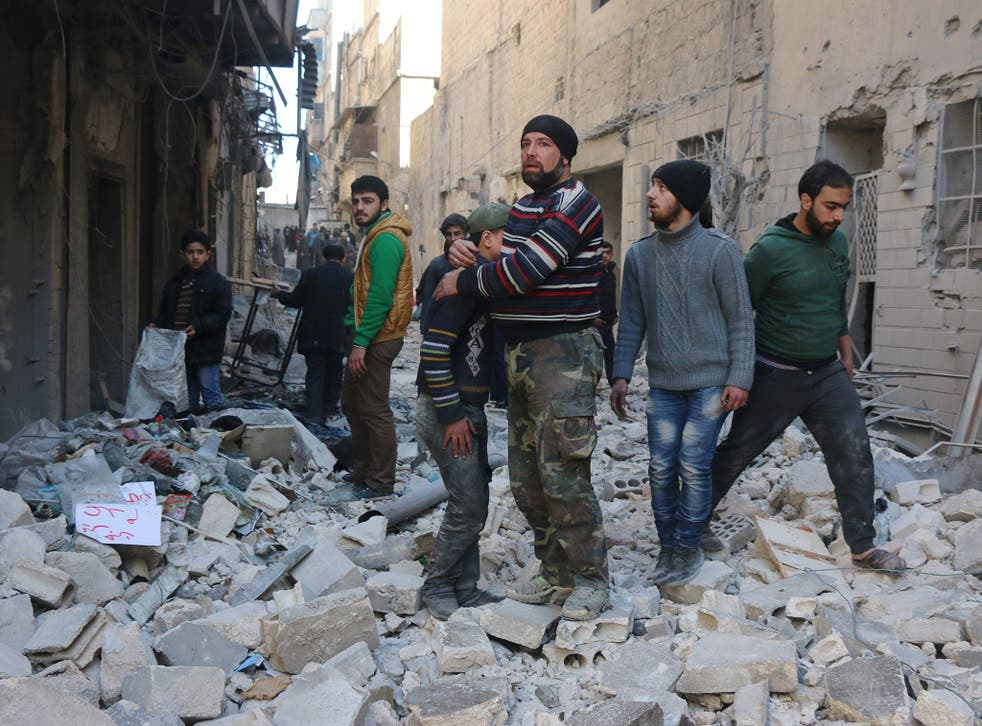 Syrian civilians among the rubble in rebel-held Aleppo after Russian-backed air strikes