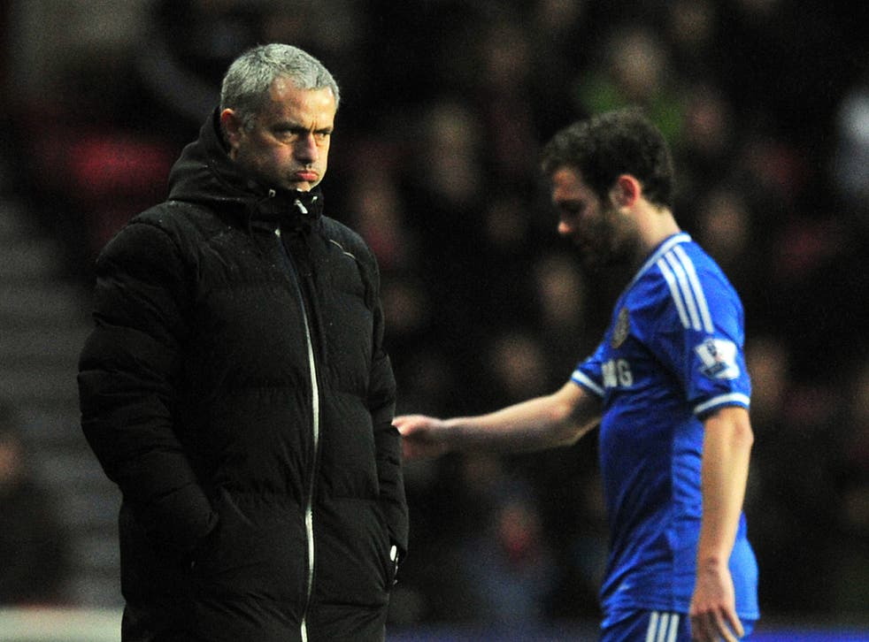 Juan Mata walks off the field without acknowledging his manager Jose Mourinho