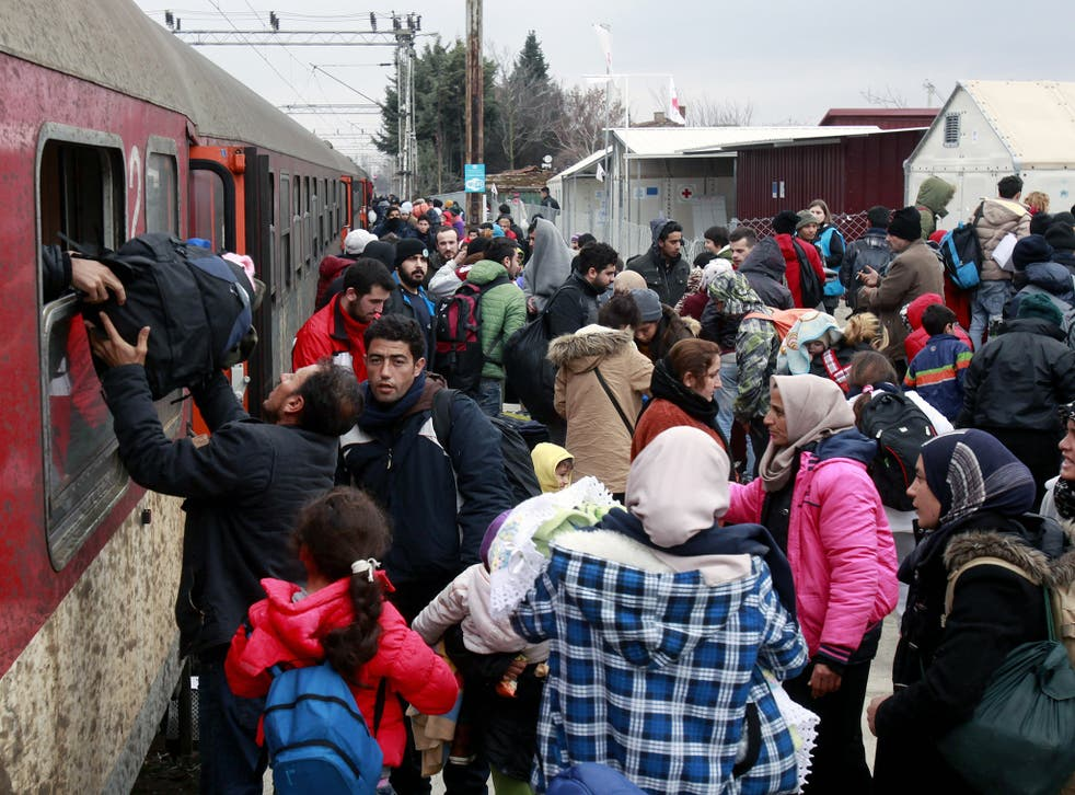 Refugees arrive by train at the transit center for refugees near northern Macedonian village of Tabanovce, before continuing their journey to Serbia